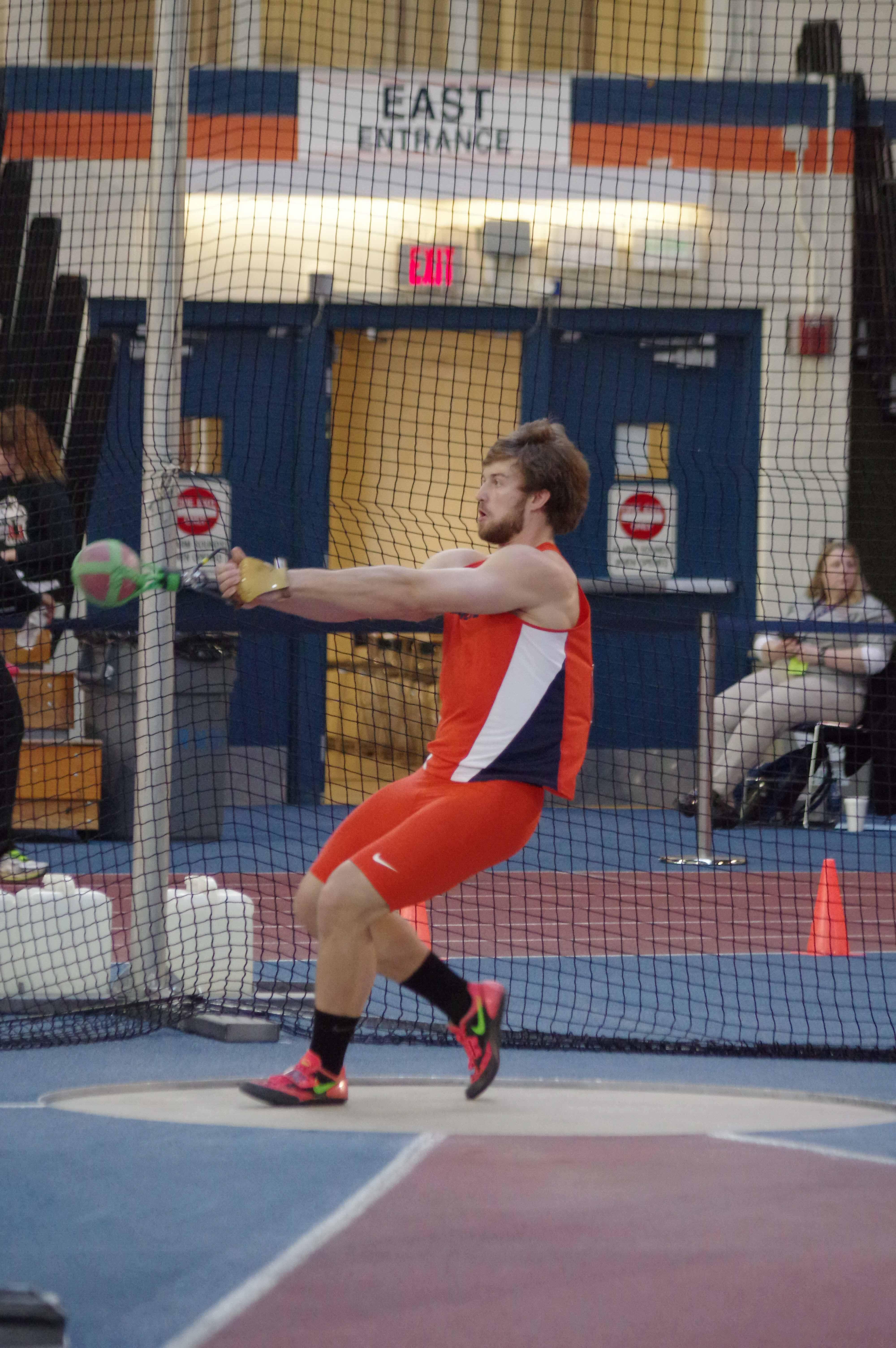 Illinois' Micheal Hyc winds up during the weight throw in the Orange & Blue Meet at the Armory on Saturday Feb. 20, 2016.