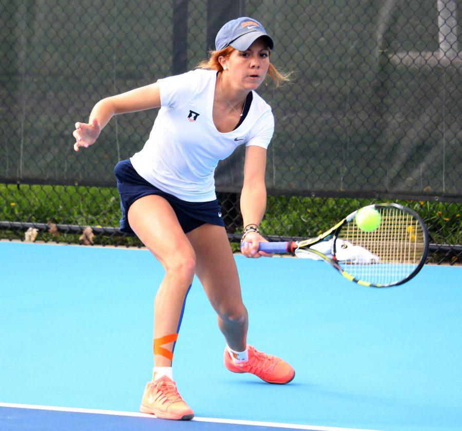 Illinois' Madie Baillon returns the ball in a match against Michigan State last April at the Atkins Tennis Center.