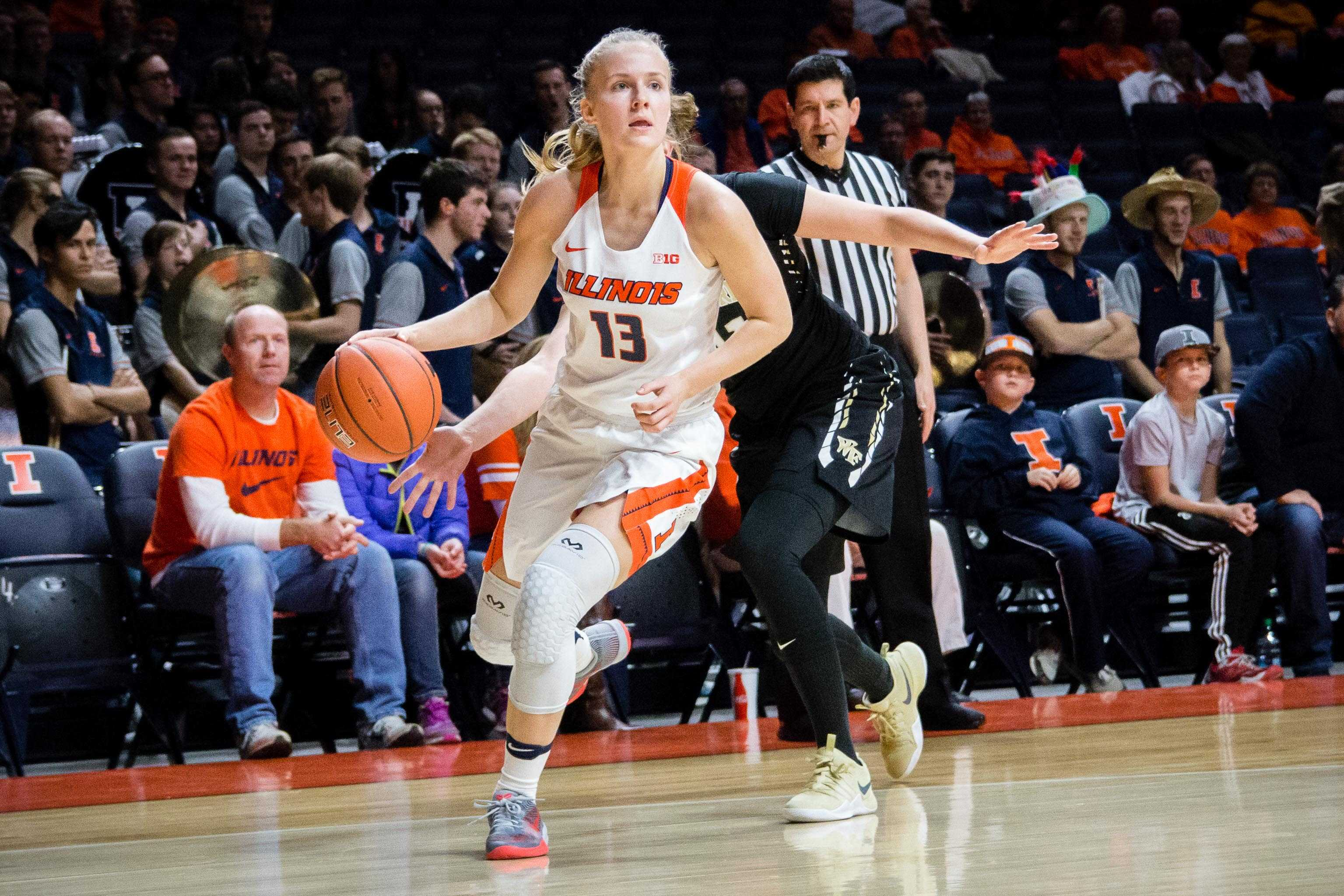 Illinois' Petra Holešínská (13) dribbles around her defender during the game against Wake Forest at State Farm Center on Wednesday, November 30. The Illini lost 79-70.