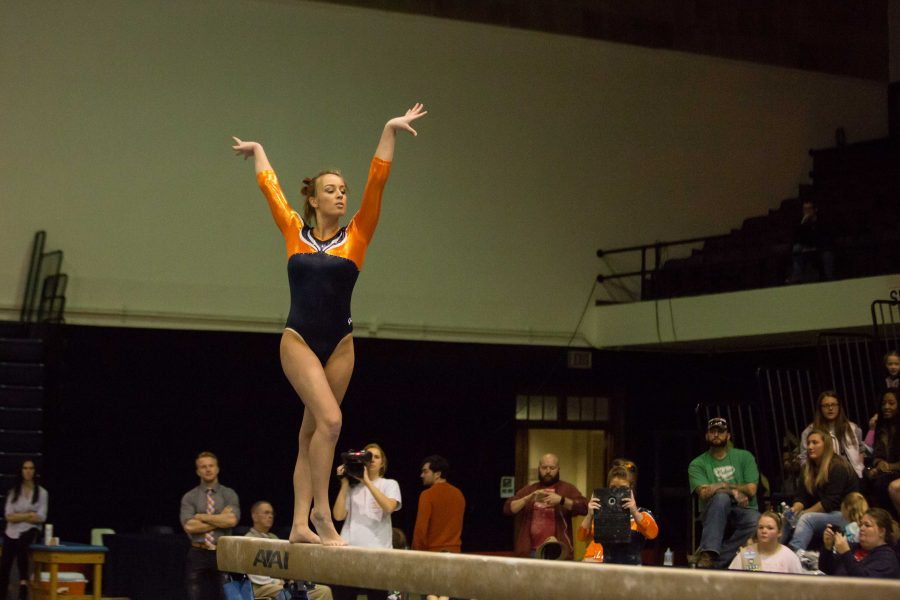Illinois' Bridget Hodan performs a routine on the balance beam during the State of Illinois Classic at Huff Hall on Saturday, March 5, 2015. The Illini claimed victory for the ninth consecutive year with a total of 195.425 over Northern Illinois (194.225), UIC(192.625) and Illinois State (191.500).
