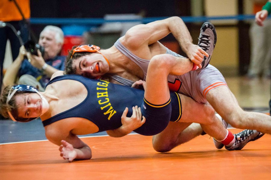 Illinois%27+Zane+Richards+wrestles+with+Michigan%27s+Stevan+Micic+in+the+133+pound+weight+class+during+the+match+at+Huff+Hall+on+Jan.+20.+Richards+won+by+decision%2C+and+the+Illini+defeated+the+Wolverines+34-6.+The+Illini%E2%80%99s+victory+moved+their+record+to+3-2+overall+and+2-2+in+the+Big+Ten.
