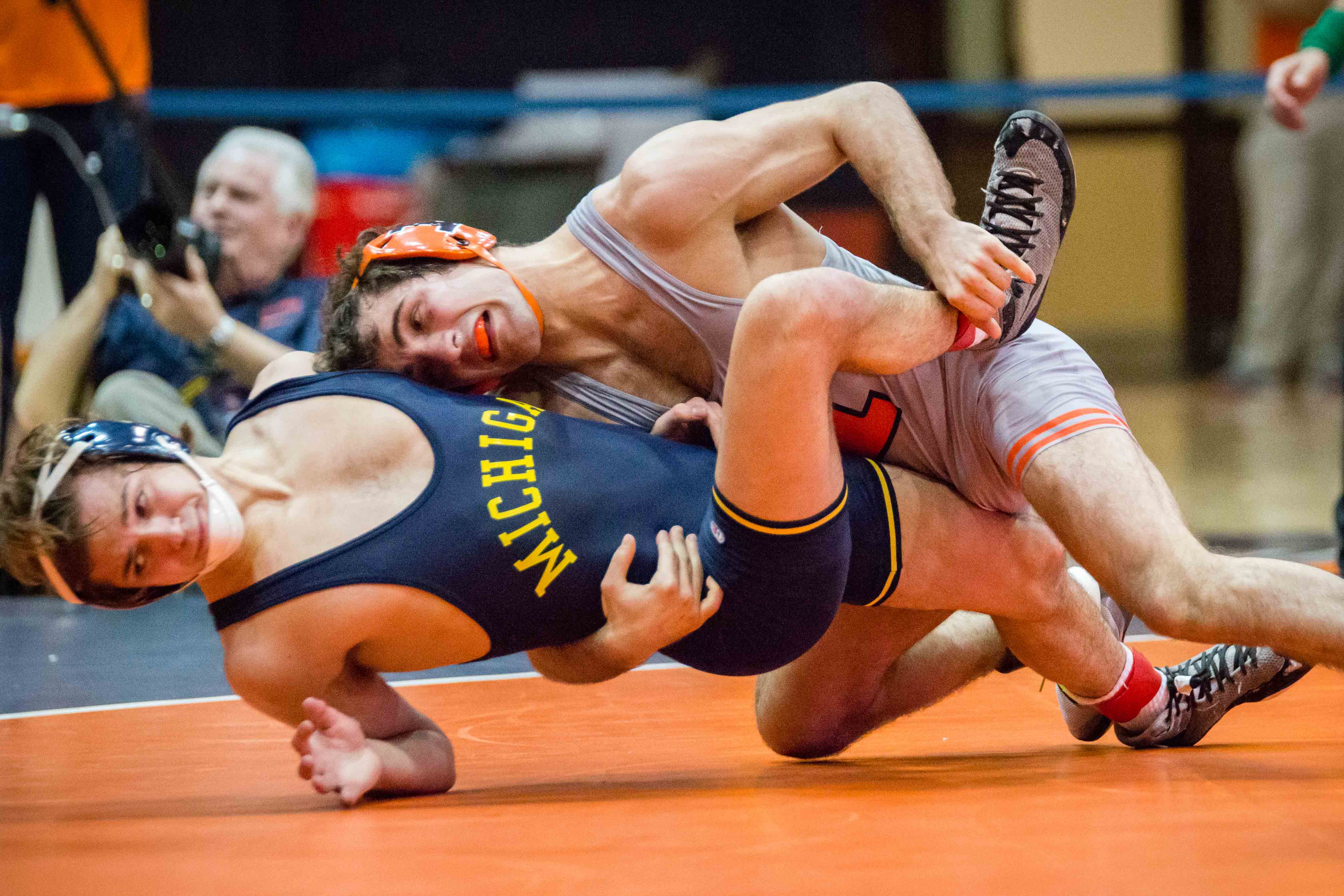 Illinois' Zane Richards wrestles with Michigan's Stevan Micic in the 133 pound weight class during the match at Huff Hall on Jan. 20. Richards won by decision, and the Illini defeated the Wolverines 34-6. The Illini's victory moved their record to 3-2 overall and 2-2 in the Big Ten.