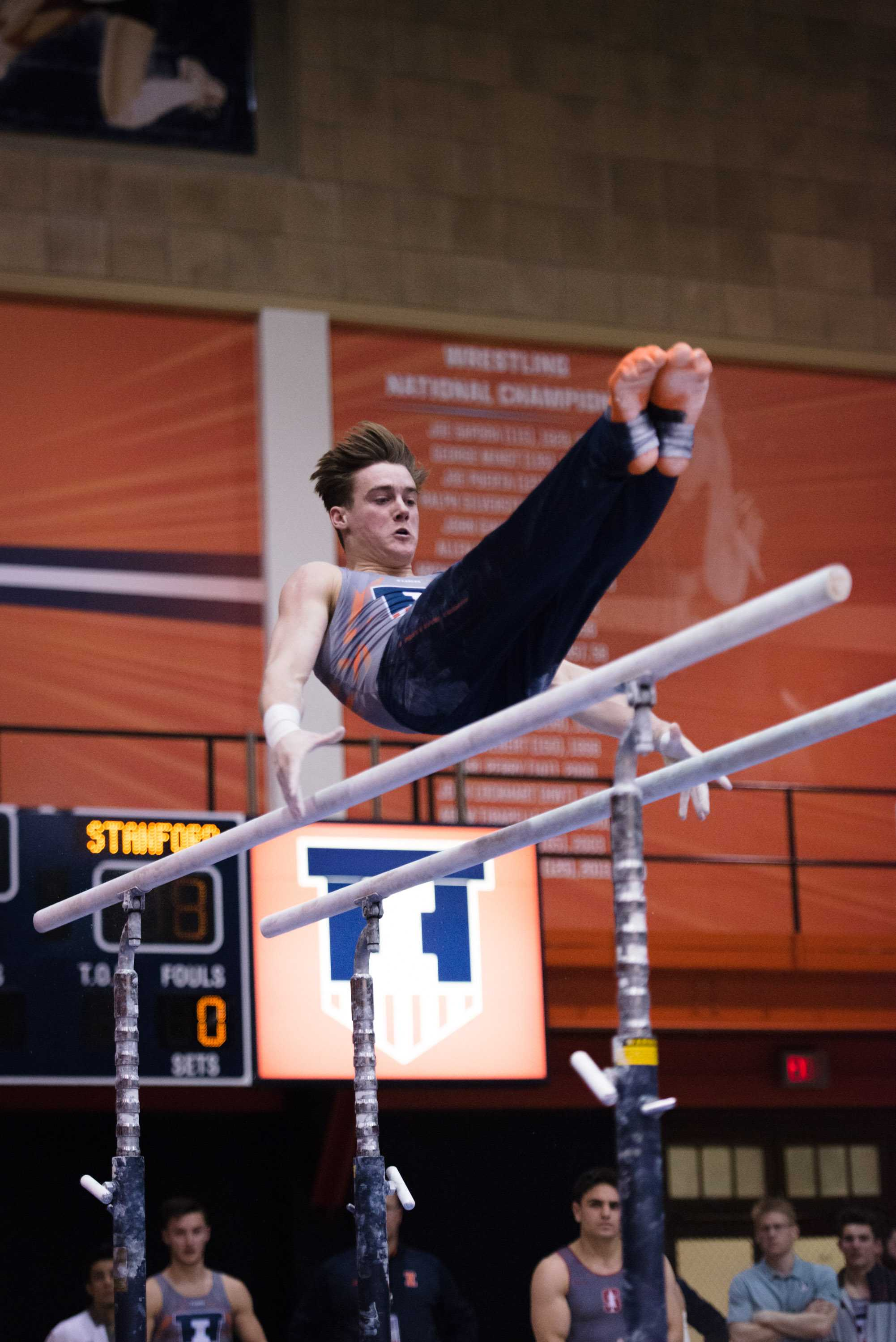 Illinois' Tyson Bull performs a routine on the parallel bars during the meet against Stanford at Huff Hall on Friday, March 6. Bull helped the Illini win the Windy City Invitational with a title on the horizontal bar.