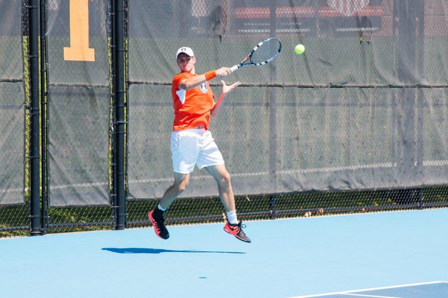 Illinois' Aleks Vukic attempts to return the ball during a meet at the Atkins Tennis Center on April 17, 2016. Vukic picked up a singles victory in the Martin King Jr. Invitational.