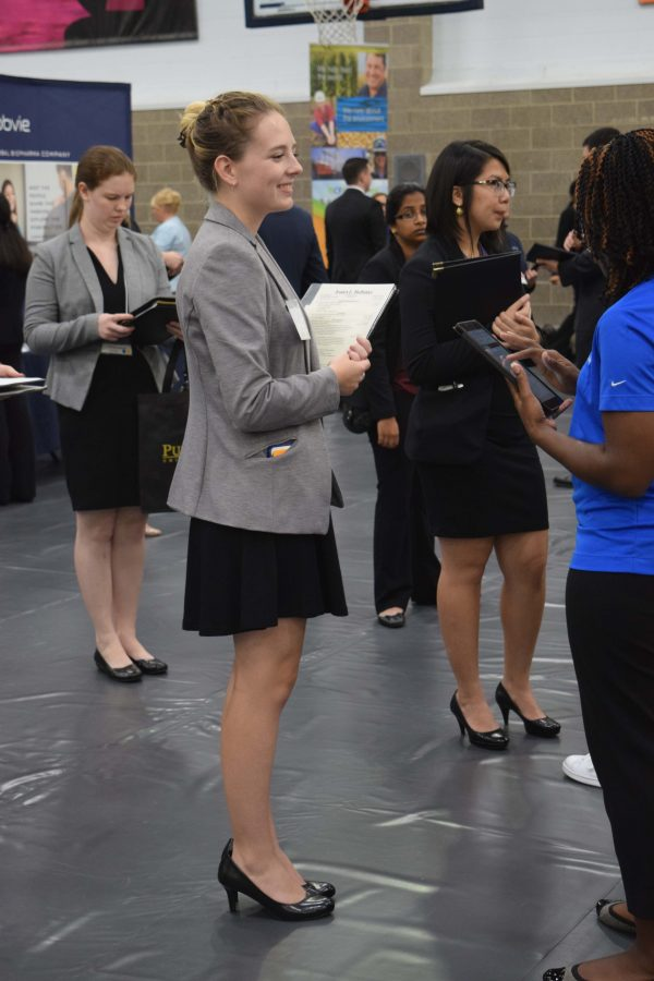 A+student+engages+with+a+potential+employer+at+the+ACES+Career+Fair+at+the+ARC.