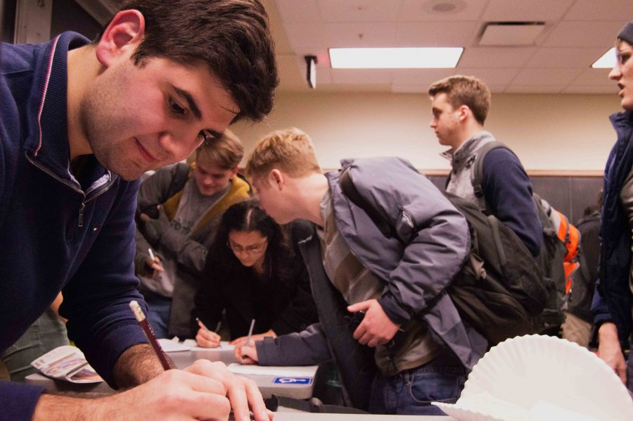Illini Progressives President Richard Daniels (left, foreground) starts a sign-up sheet for one of the RSO's subcommittees on Jan. 26, 2017.