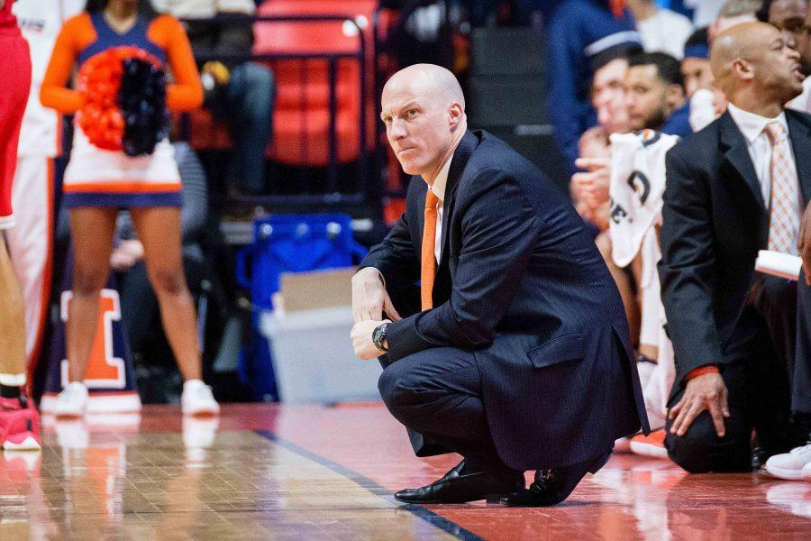 Illinois head coach John Groce watches his team from the sidelines during the game against Ohio State at State Farm Center on Sunday, January 1.