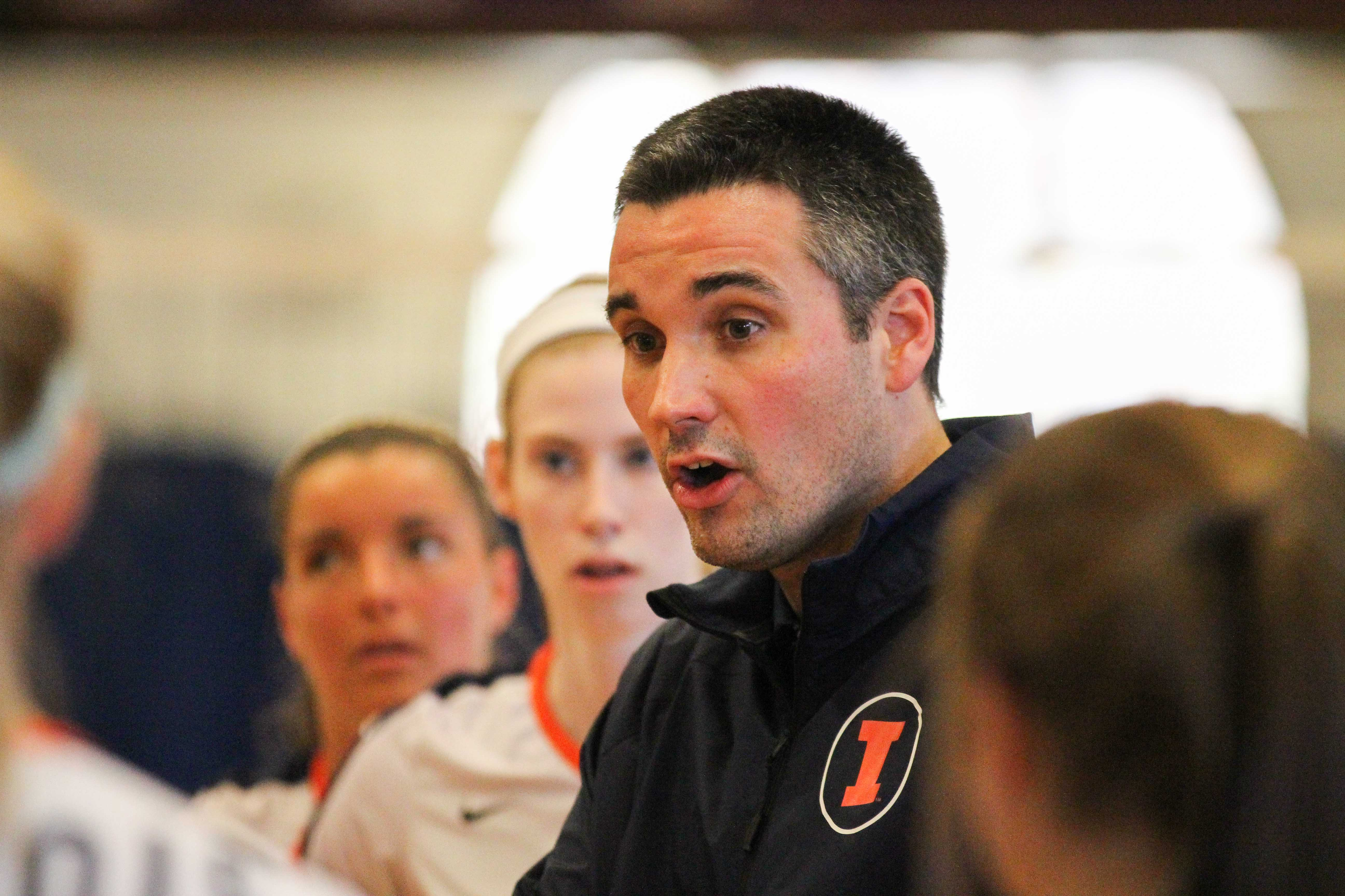 Illinois' head coach Kevin Hambly talks with his team during the Illinois vs. Kentucky volleyball game at Kenney Gym on Saturday, April 19, 2014.  The Illini won 3-1.