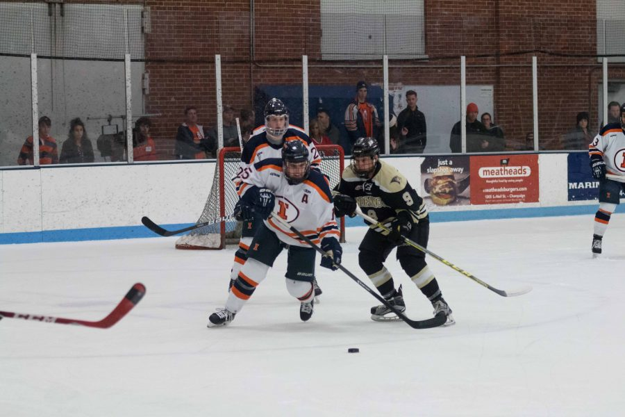 Illinois%27+Eric+Cruickshank+fights+for+possession+of+the+puck+during+the+game+against+Lindenwold+University+at+the+Ice+Arena+on+Saturday%2C+January+30.+The+Illini+lost+4-1.