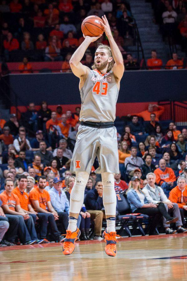 Illinois' Michael Finke (43) shoots a three during the game against Iowa at State Farm Center on Wednesday.