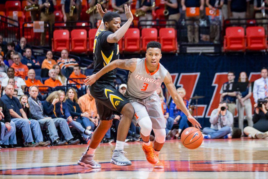 Illinois' Te'Jon Lucas (3) dribbles around his defender during the game against Iowa at State Farm Center on Wednesday, January 25.
