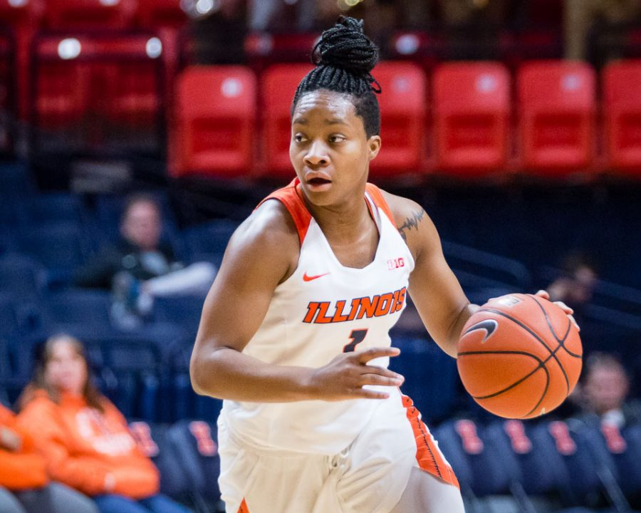 Illinois' Brandi Beasley (1) dribbles the ball at the top of the key during the game against Maryland at State Farm Center on Thursday, January 26.