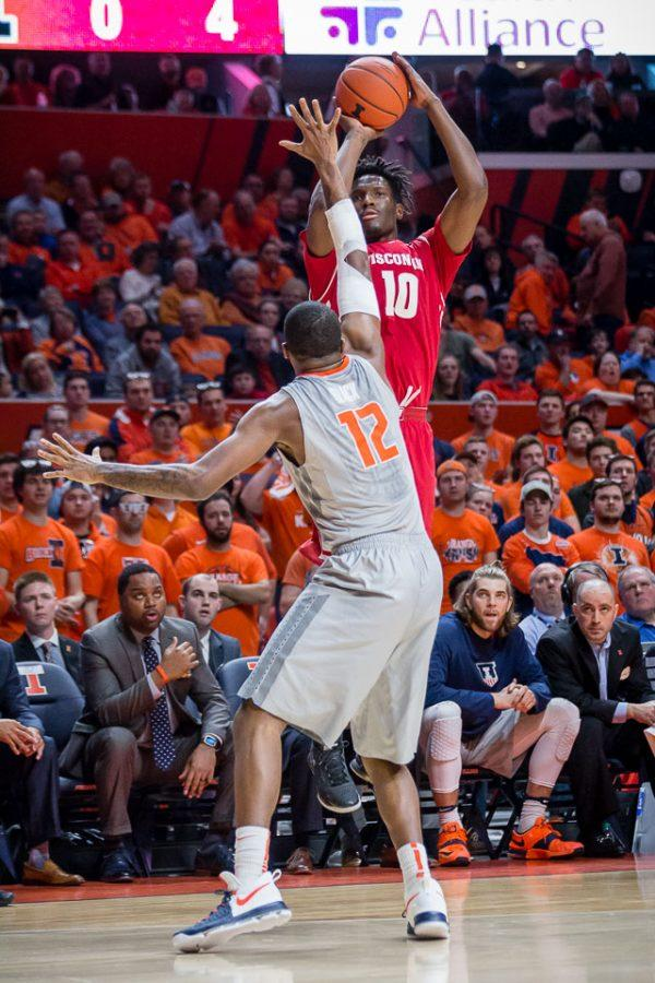 Wisconsin's Nigel Hayes (10) shoots a three over Illinois' Leron Black (12) during the game at State Farm Center on Tuesday, January 31. The Illini lost 57-43.