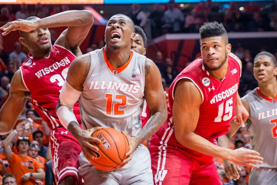 Illinois' Leron Black (12) gets ready to go up for a layup after grabbing an offensive rebound during the game against Wisconsin at State Farm Center on Tuesday, January 31. The Illini lost 57-43.