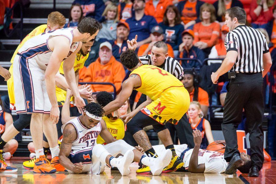 Illinois' Tracy Abrams hits the floor in anger after picking up his third foul during the game against Maryland at State Farm Center on Jan. 14. The Illini lost 62-56. Columnist Matt Gertsmeier believes Illinois' loss-win pattern is promising for the team's next matchup.