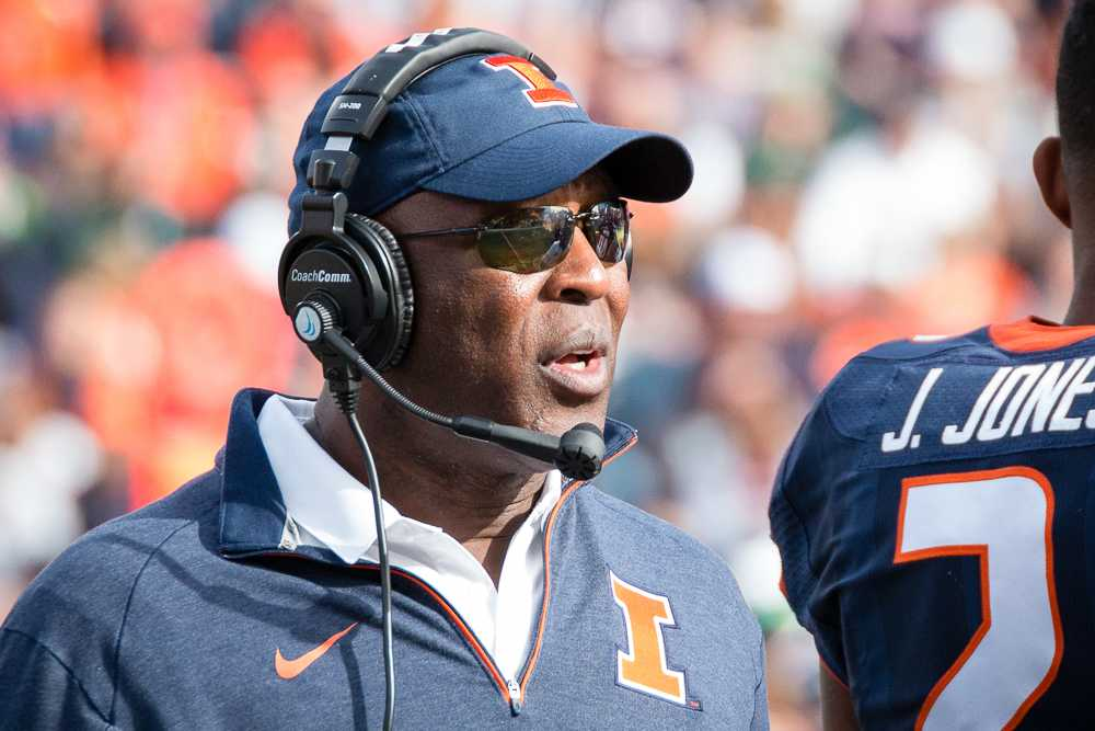 Illinois head coach Lovie Smith talks to his team during a timeout in the game against Michigan State at Memorial Stadium on Saturday, November 5. The Illini won 31-27.