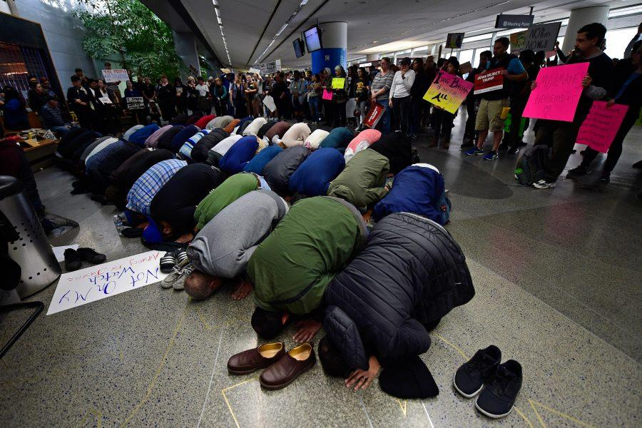 People of the Muslim faith pray near the international arrival gates on Sunday, Jan. 29, 2017 while attending a protest at San Francisco International Airport in San Francisco, Calif. Protestors gathered at airports around the country to protest over President Donald Trump's executive action prohibiting Muslims from certain countries from entering into the United States.