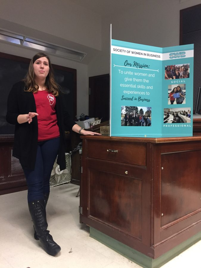 Brittany Marsh, president of the Society of Women in Business, presents to prospective members at an info night Thursday, Jan. 26. The  group aims to develop members' professional and personal skills.