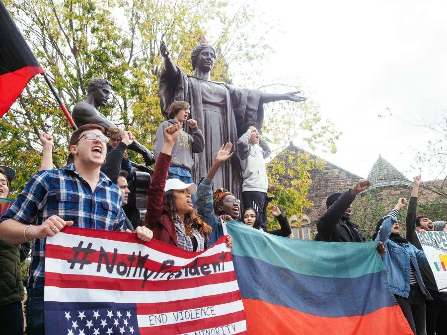 Students+gather+at+Alma+Mater+to+march+through+the+Quad+and+down+Green+Street+in+order+to+protest+President+Elect+Donald+Trump+on+Friday.