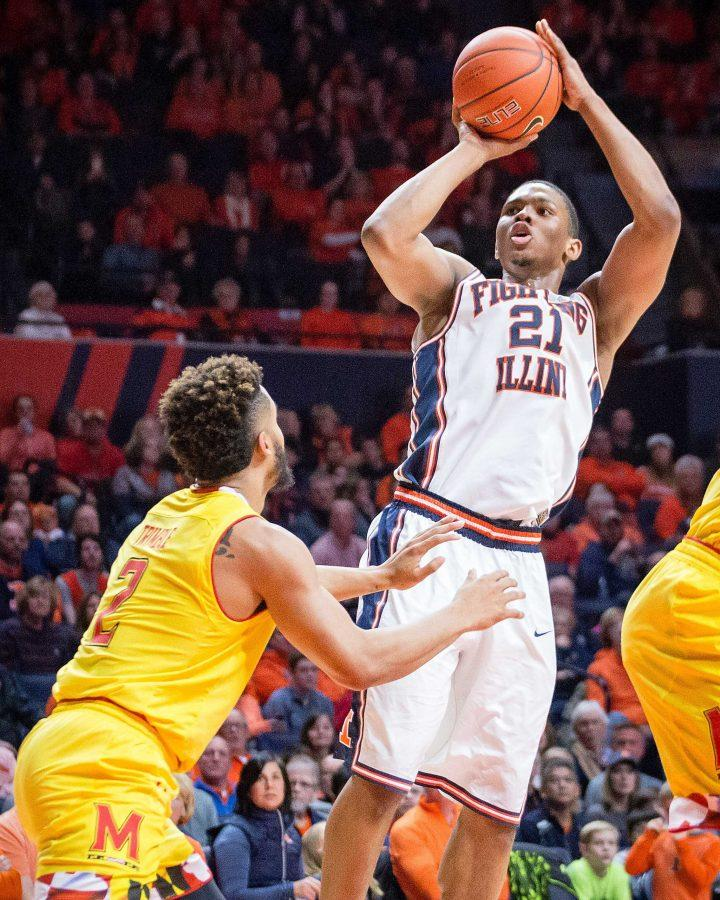 Illinois' Malcolm Hill (21) shoots a pull-up jumper over Maryland's Melo Trimble during the game at State Farm Center on Saturday, January 14. The Illini lost 62-56.