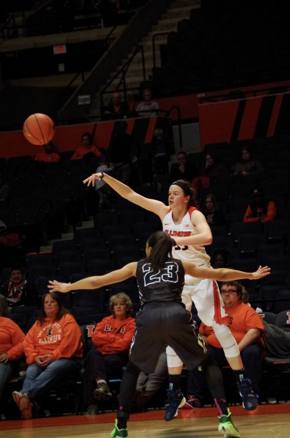 Illinois Alex Wittinger (35) jumps above her opponent to pass the ball to her teamate at the game against Michigan State on Wednesday, Feb. 24th, 2016. The Illini lost 43-71.