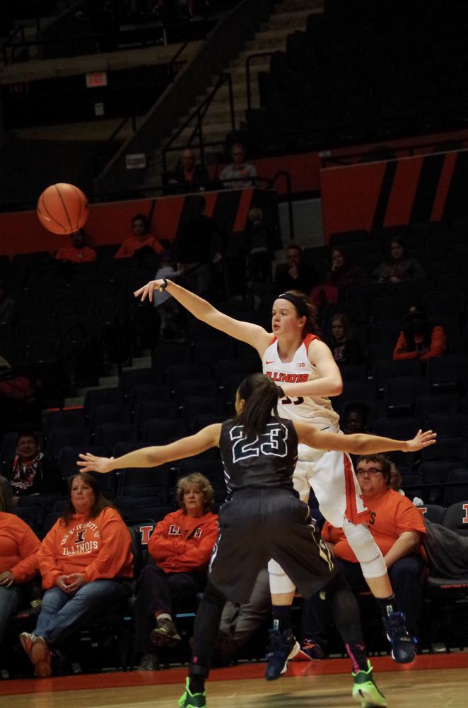 Illinois' Alex Wittinger (35) jumps above her opponent to pass the ball to her teamate at the game against Michigan State on Wednesday, Feb. 24th, 2016. The Illini lost 43-71.