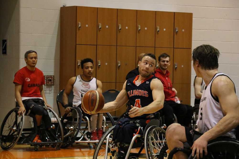 Illini's Ryan Neiswender takes the ball down the court against the Canadian National Team at the ARC on Jan. 28th.