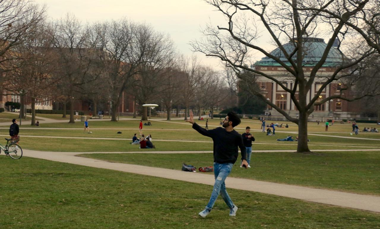 Students take advantage of the warm weather and play frisbee on the quad on Monday.