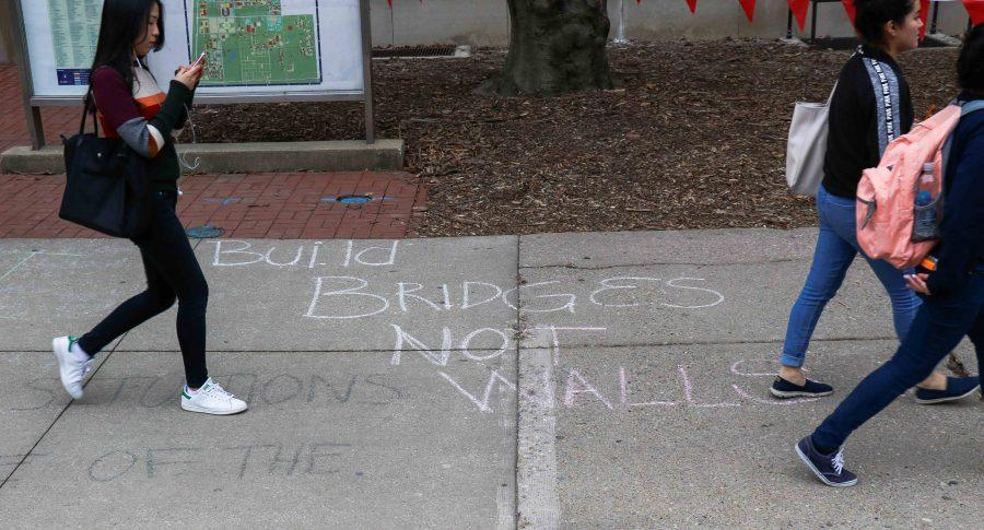 Chalk written on the Wright Street sidewalk in front of the Henry Administration Building on Thursday, Feb. 23.