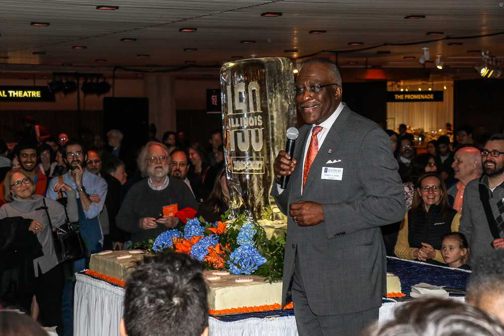 Chancellor Robert Jones talks to the crowd before cutting the first slice into the cake celebrating the University's 150th birthday at the Krannert Center for Performing Arts on Tuesday.