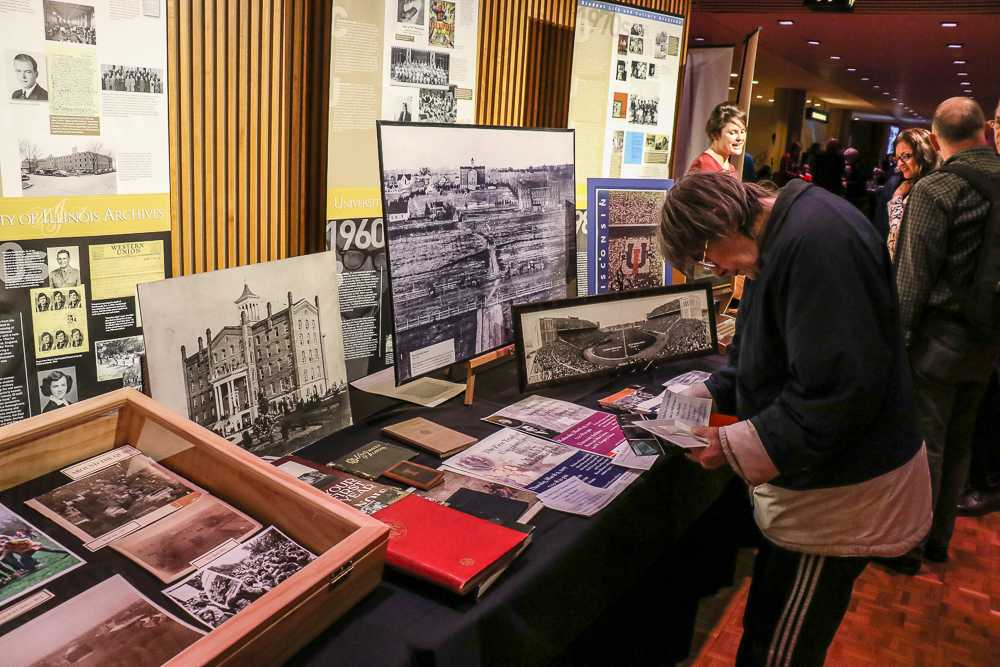 Sesquicentennial ceremony attendees examine documents from the University Archives at the Krannert Center on Feb. 28.
