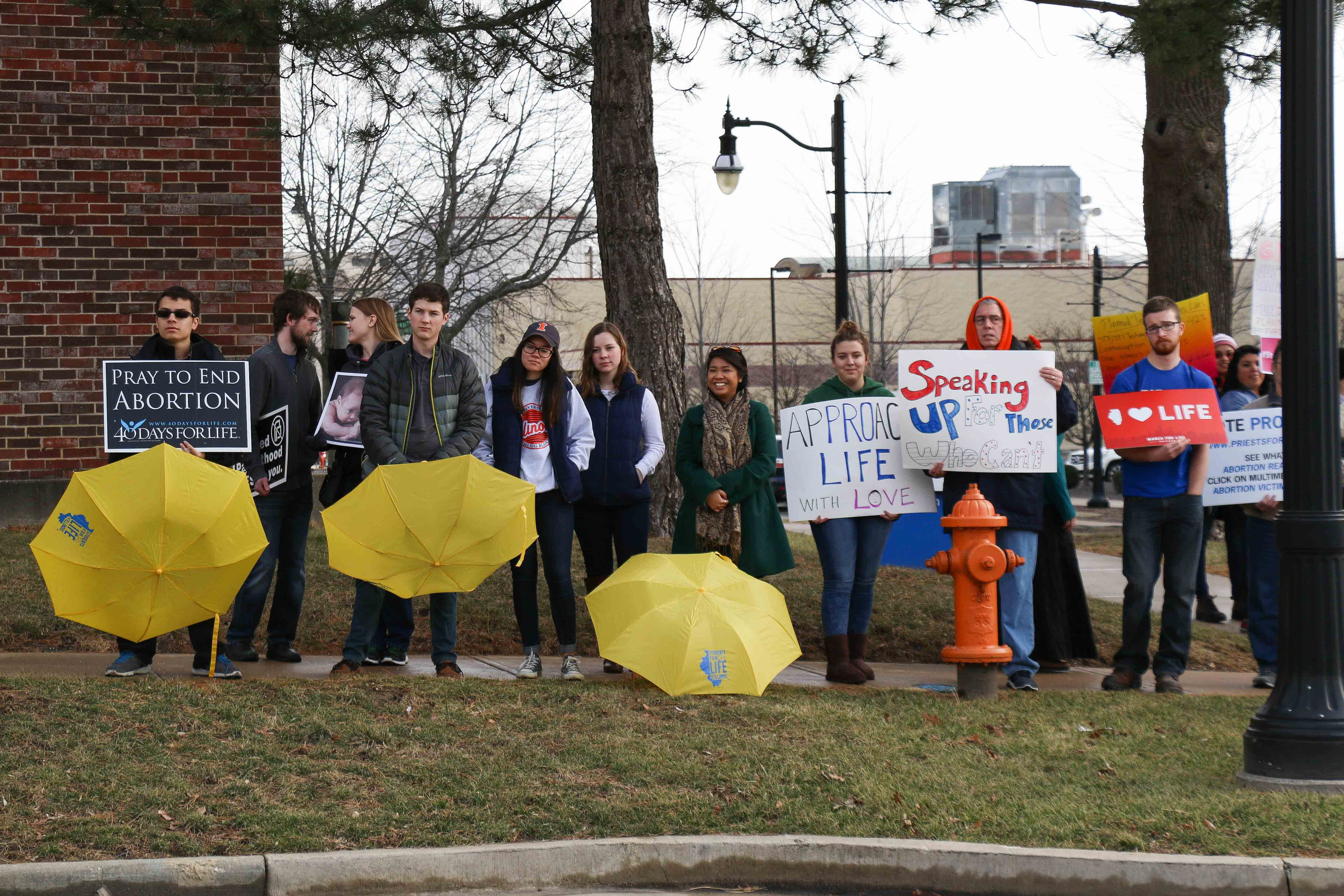 A group gathers to protest federal funding of Planned Parenthood on Saturday.