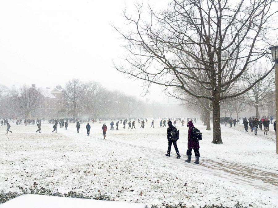Students walk on the Quad in the snow on Wednesday, Feb. 8th.
