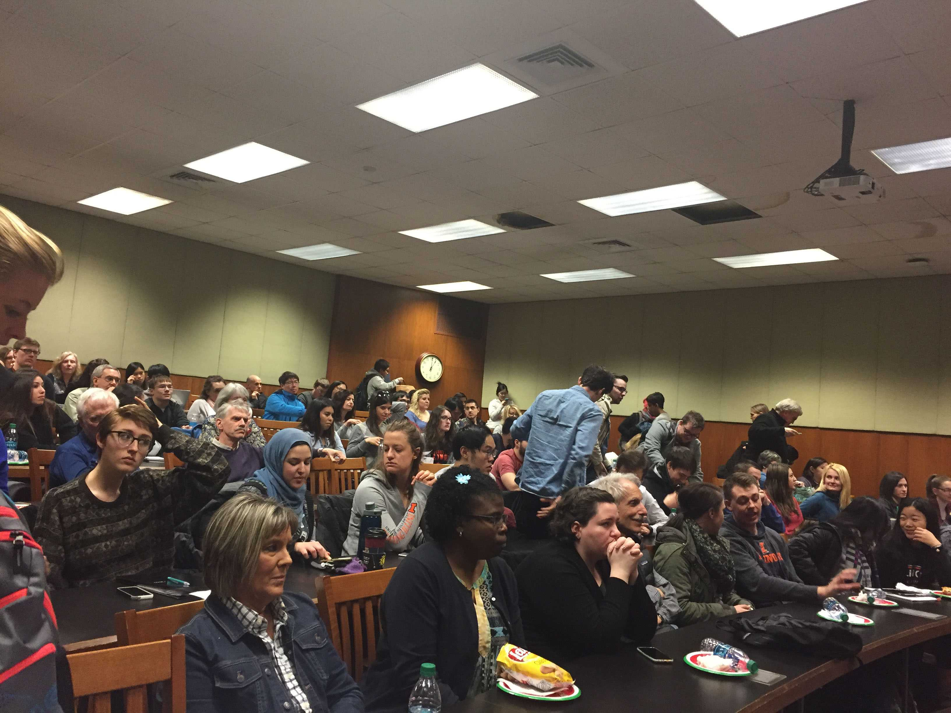 Students and faculty gather Friday for the College of Law's panel discussing President Donald Trump's executive order limiting immigration from the Middle East.