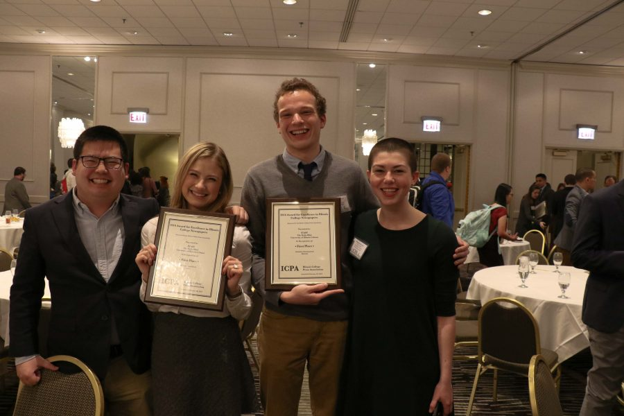 The+Daily+Illini+executive+team+holds+two+of+the+awards+from+this+weekend%27s+Illinois+College+Press+Association+ceremony.