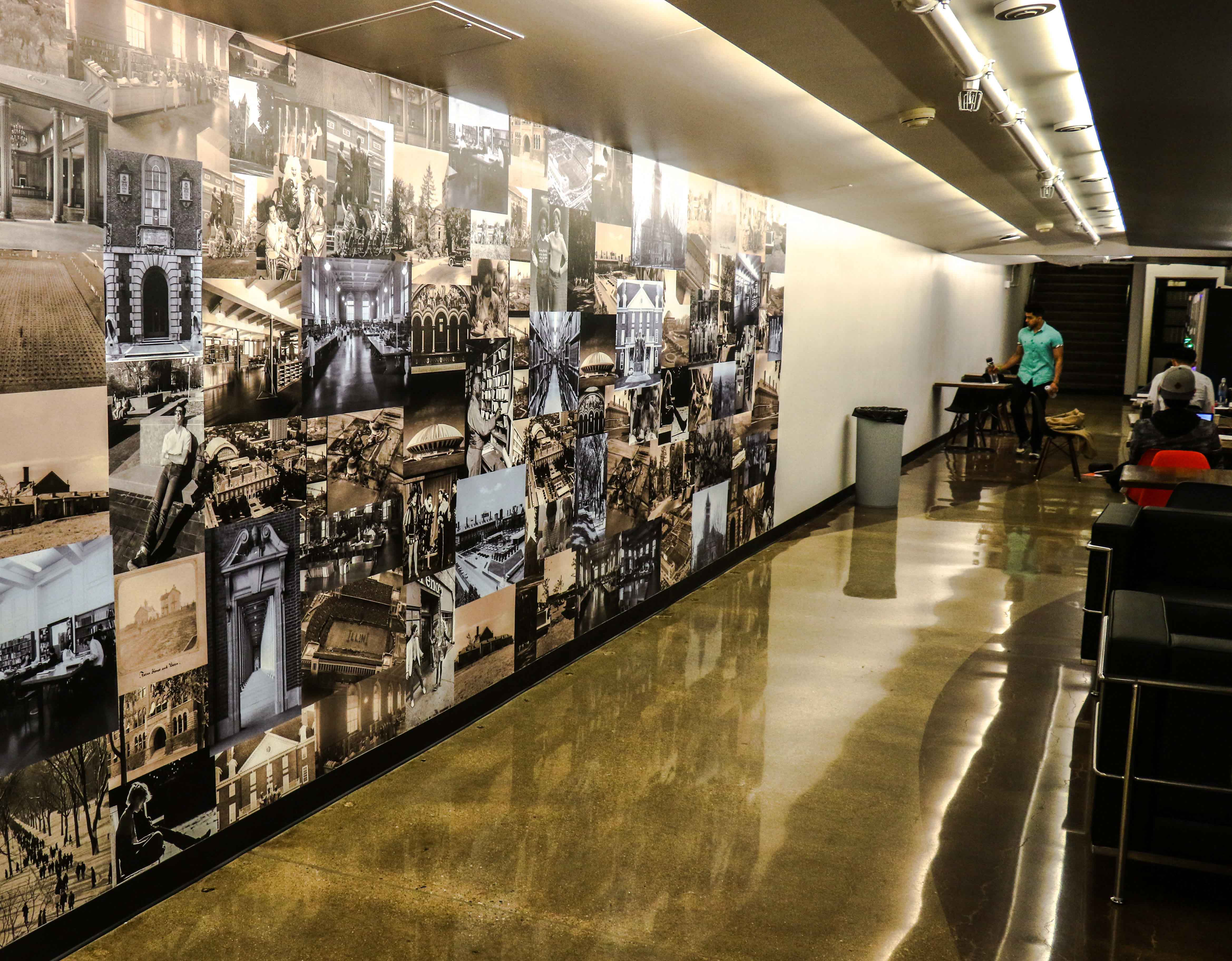 Students study in the tunnel connecting the UGL and the Main Library. The murals were recently added to celebrate the University's history.