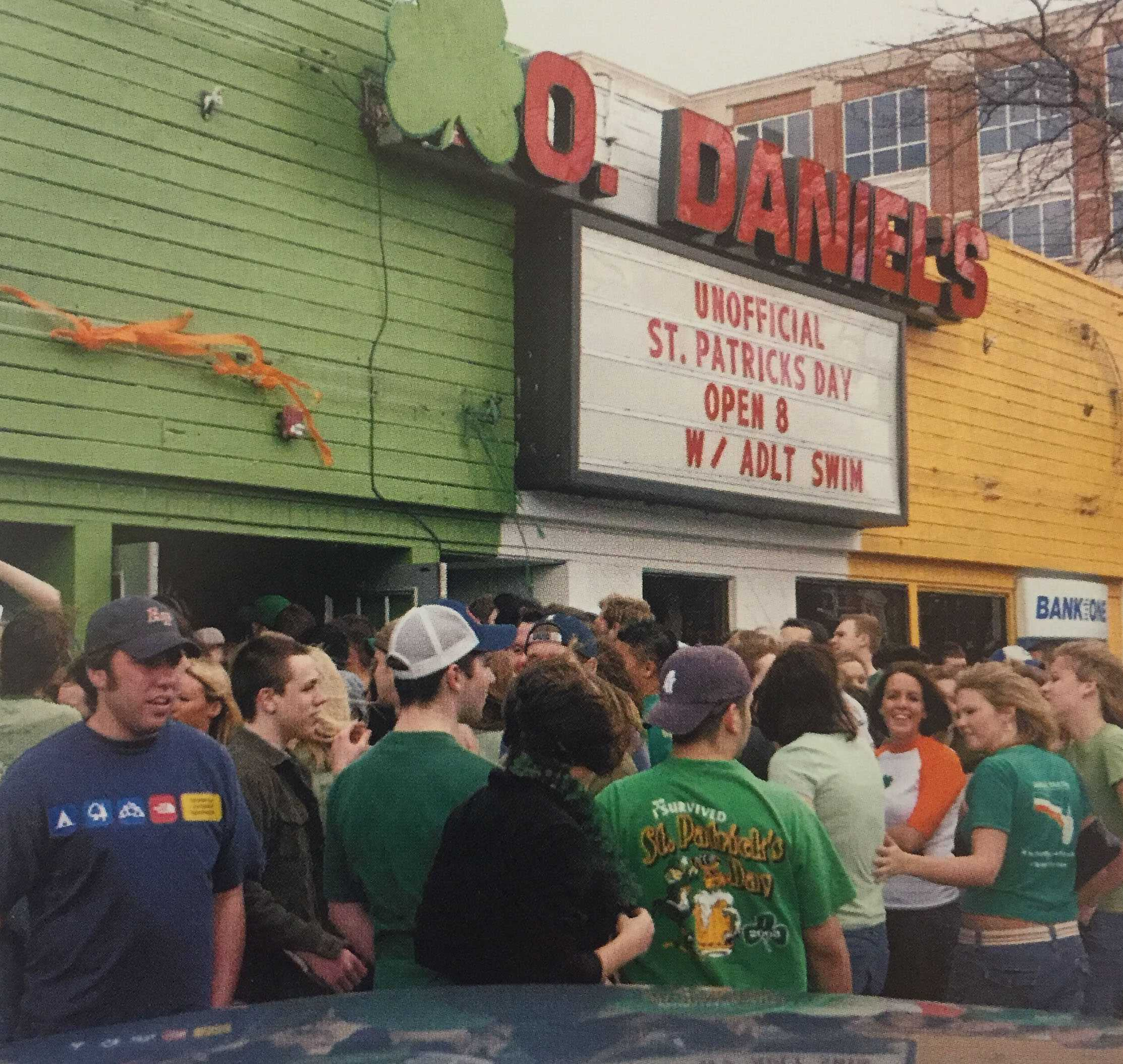 Students wait outside Co. Daniels, a popular bar at the time, on Unofficial, March 5th, 2004.