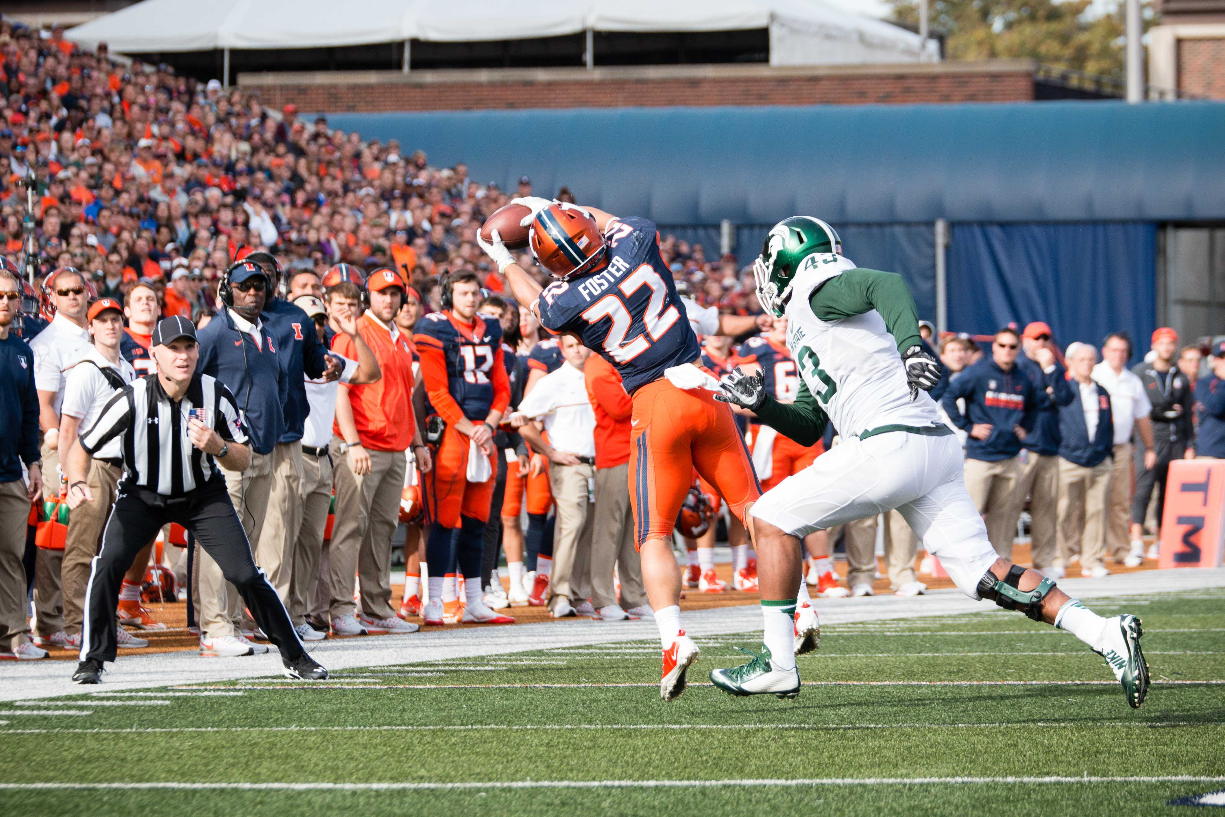 Illinois running back Kendrick Foster catches a pass during the game against Michigan State at Memorial Stadium on Saturday, Nov. 5. Foster received the Mental Toughness Award for his actions off the field.