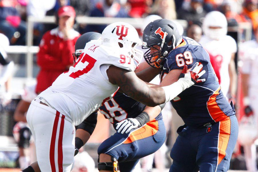 Illinois' Ted Karras (69) defends Indiana's Larry Black, Jr. (97) during the game against Indiana at Memorial Stadium on Saturday, Oct. 27, 2012.