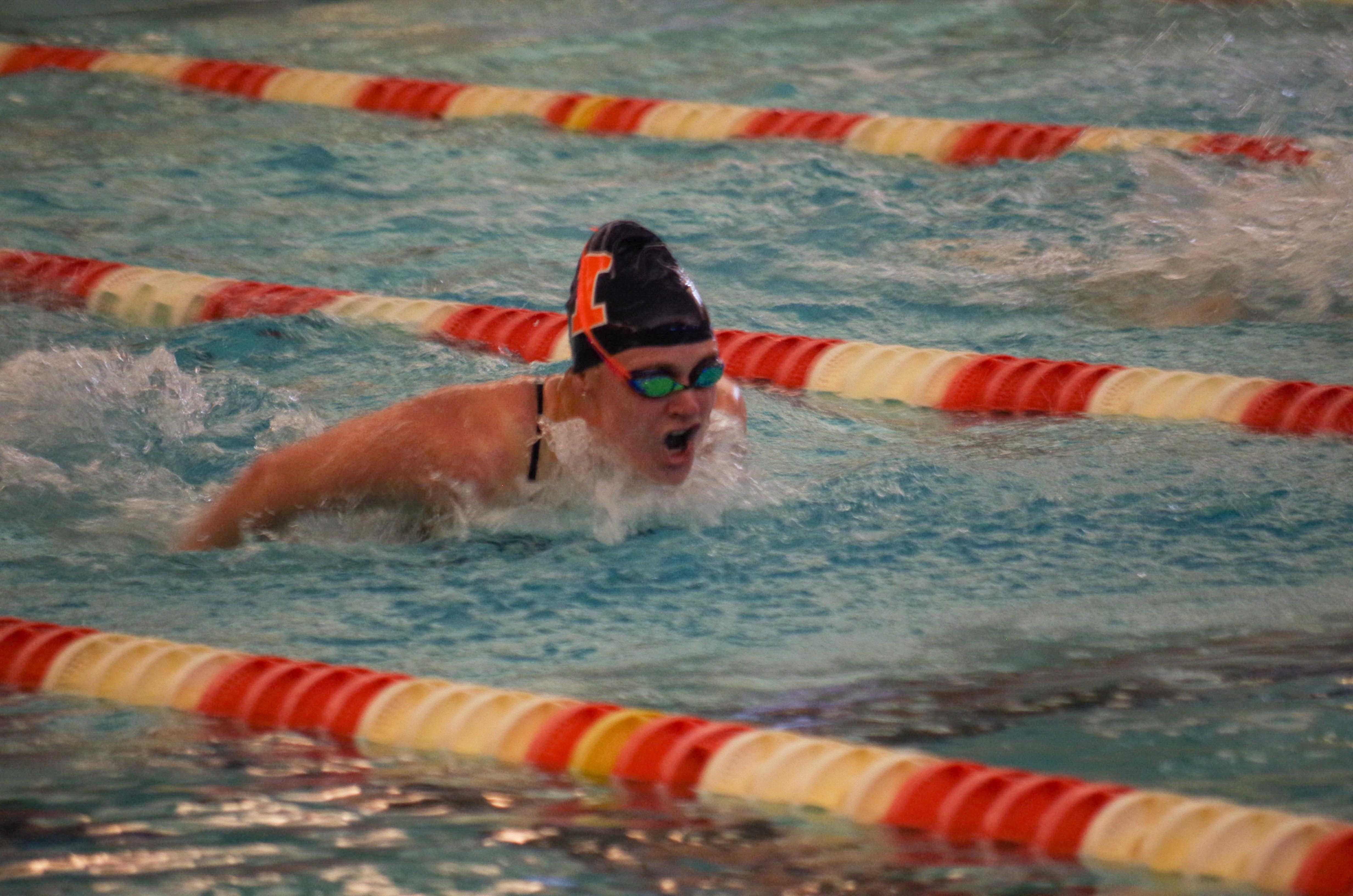Illini's Samantha Stratford swims the butterfly against Nebraska on Jan. 21st in the ARC pool.
