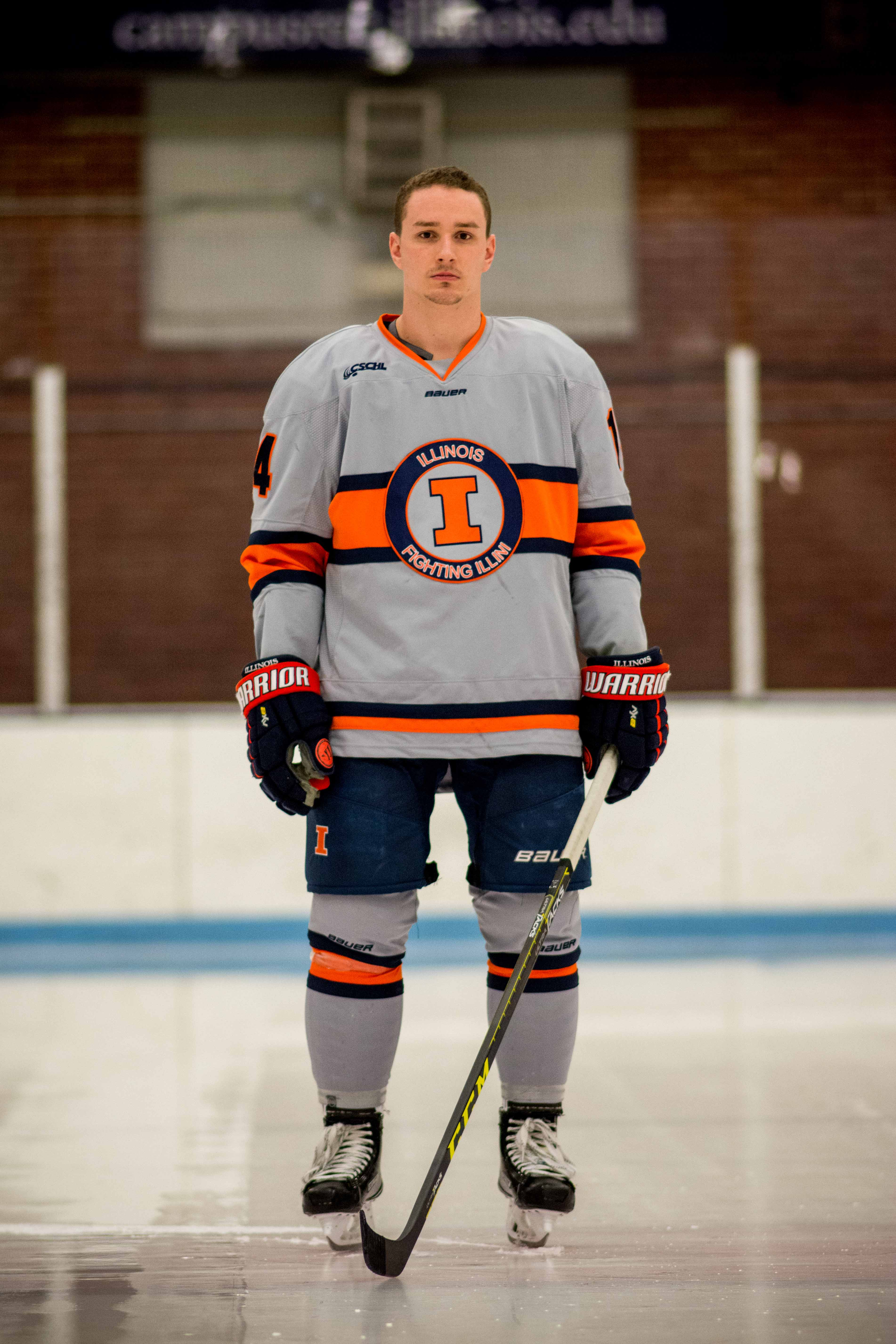 Illinois hockey forward Chris Lozinak looks to his grandfather for support.