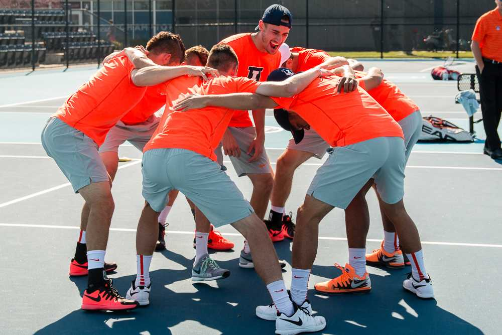 Illinois Men's Tennis huddles up before the match against Michigan State on April 15, 2016.