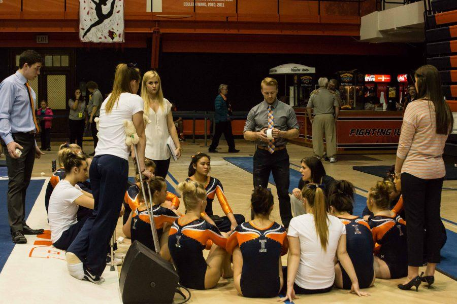 Illinois' head coach Kim Landrus talks to the team after the compete on four events during the State of Illinois Classic at Huff Hall on Saturday, March 5, 2015. The Illini claimed victory for the ninth consecutive year with a total of 195.425 over Northern Illinois (194.225), UIC(192.625) and Illinois State (191.500).