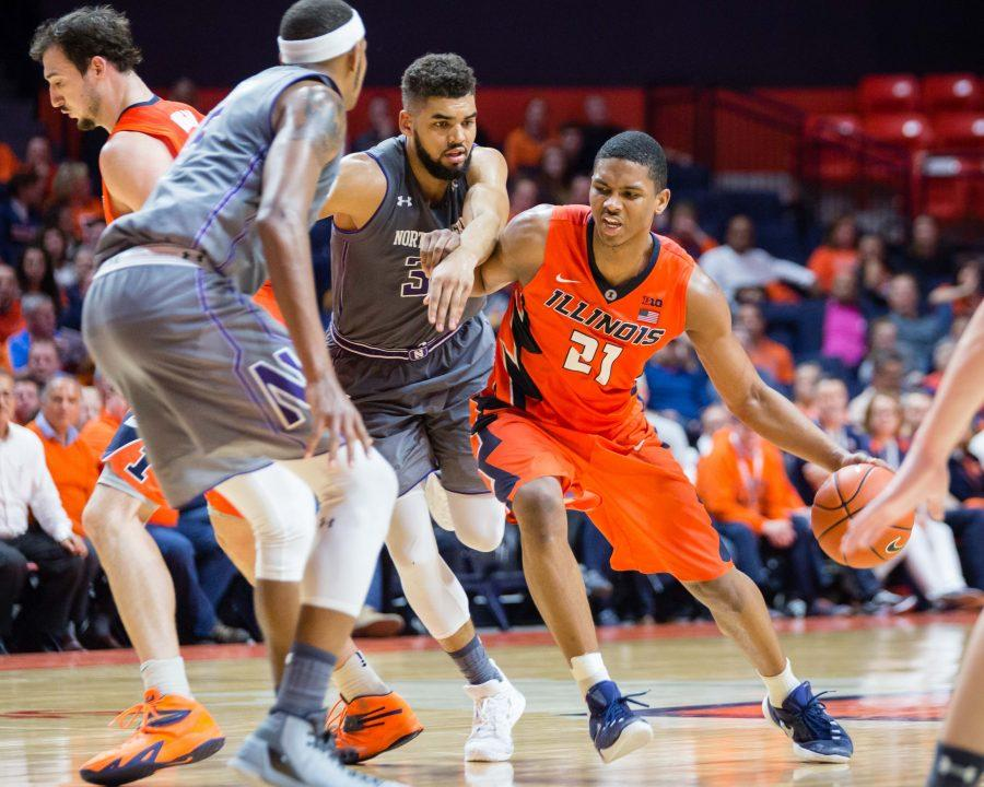 Illinois' Malcolm Hill drives to the basket during the game against Northwestern on Tuesday. Hill is now in sixth place on Illinois all-time scoring list.