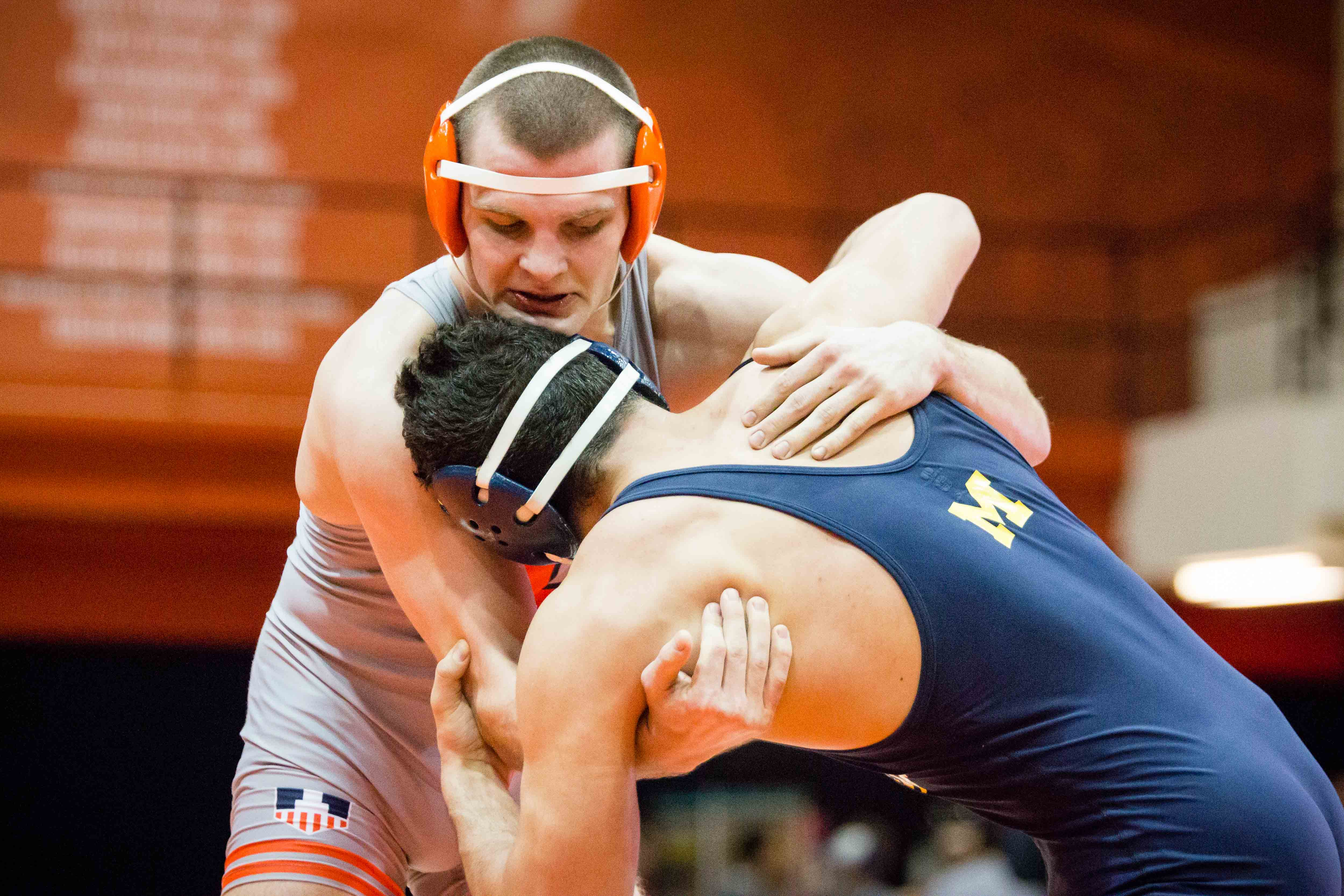 Illinois' Zac Brunson wrestles with Michigan's Myles Amine in the 174 pound weight class during the match at Huff Hall on Friday, Jan. 20. Brunson celebrated his 100th win against Indiana from his final home match Sunday. The Illini ended the regular season 9-3, 6-3.