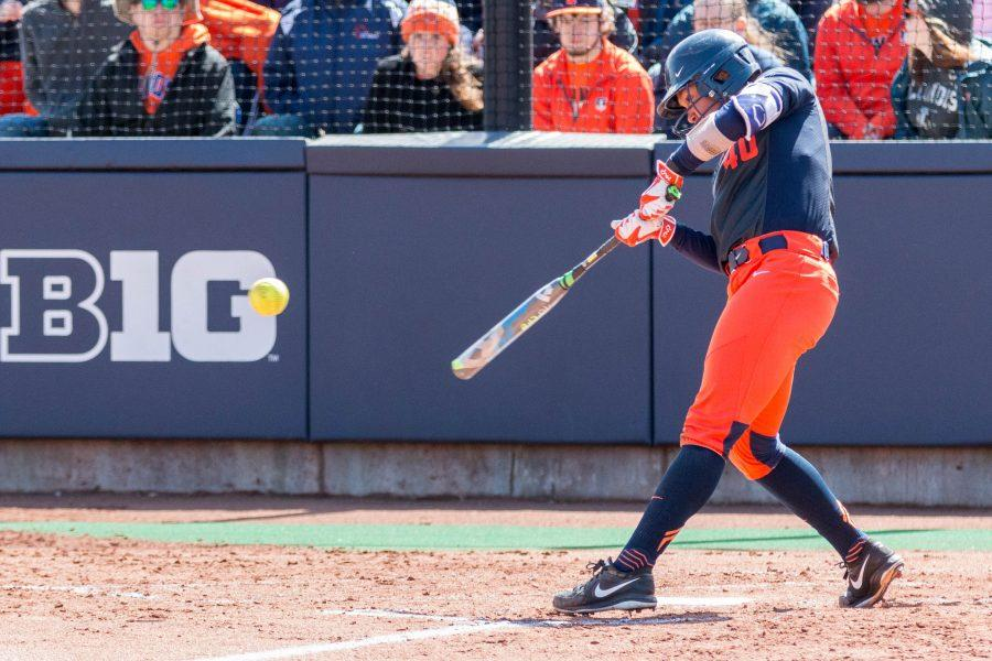 Illinois%E2%80%99+Nicole+Evans+hits+a+solo+home+run+to+center+field+at+Eichelberger+Field+on+April+2.+She+opened+the+tournament+this+past+weekend+by+hitting+another+home+run.+The+Illini+came+home+from+Puerto+Rico+with+a+4-1+record.+