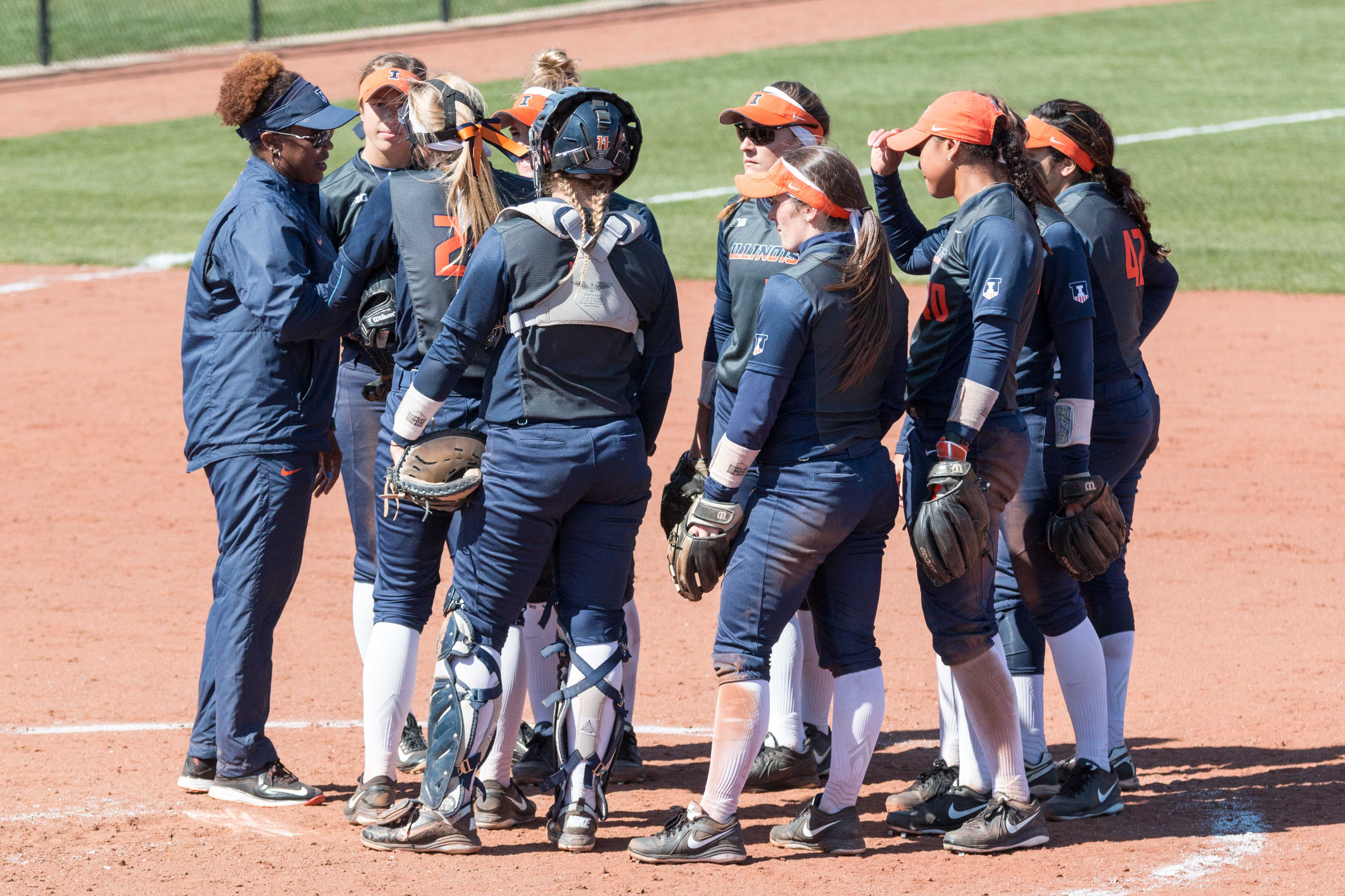 Illinois head coach Tyra Perry talks to her team during game one of the doubleheader against Nebraska at Eichelberger Field on Saturday, March 26. The Illini won game one 8-3 and game two 10-2.