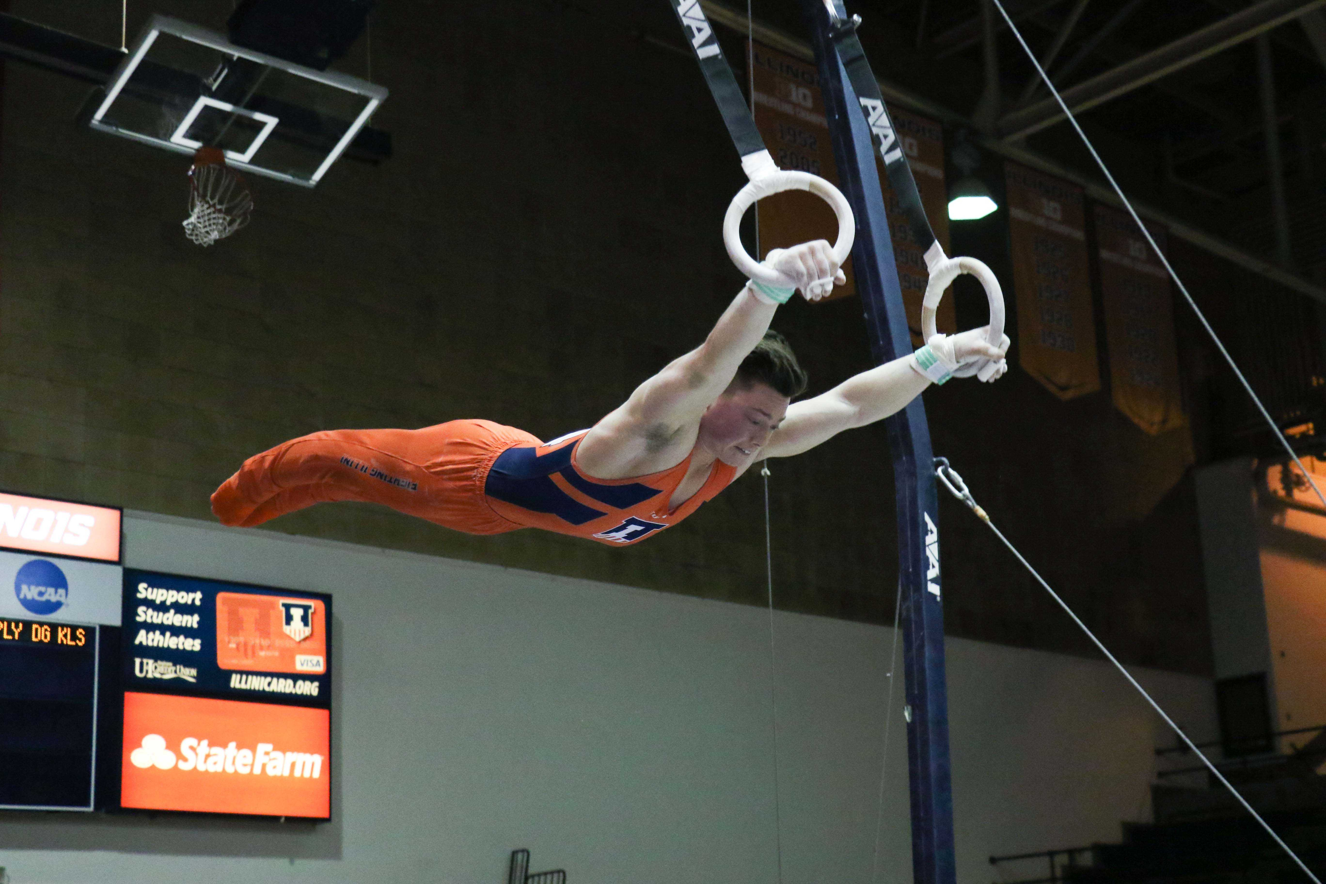 Illinois' Alex Diab works the still rings at the meet against Minnesota in Huff Hall Saturday. His score tied the season high.