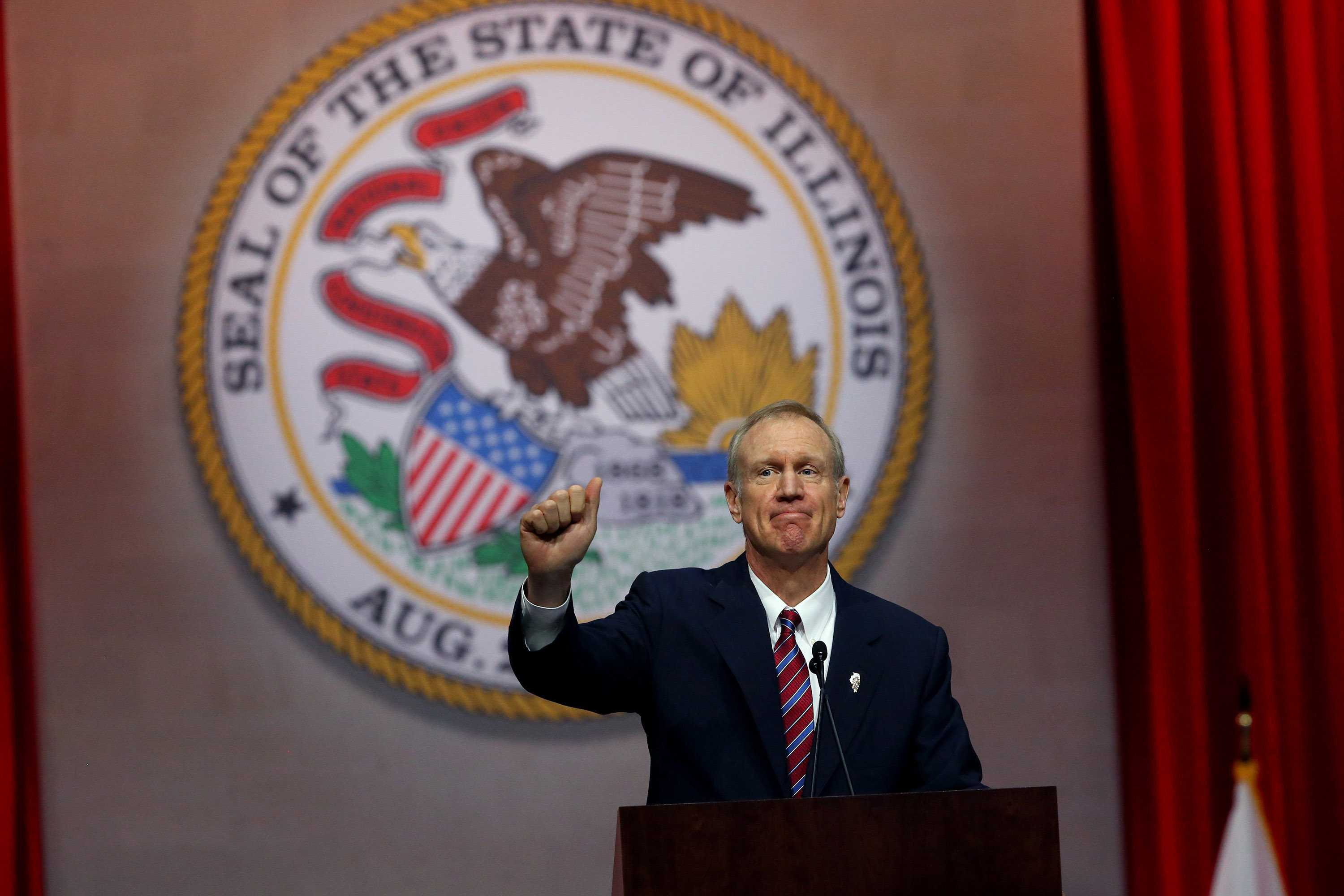 Gov. Bruce Rauner gives a thumbs up after giving his first speech as governor on Monday Jan. 12, 2015 at the Prairie Capital Convention Center in Springfield, Ill.