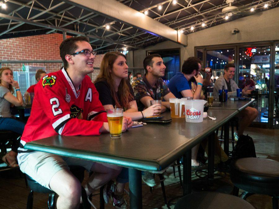 Blackhawks fans eagerly watch the game at Legends Bar in Champaign, IL. Monday, April 25.